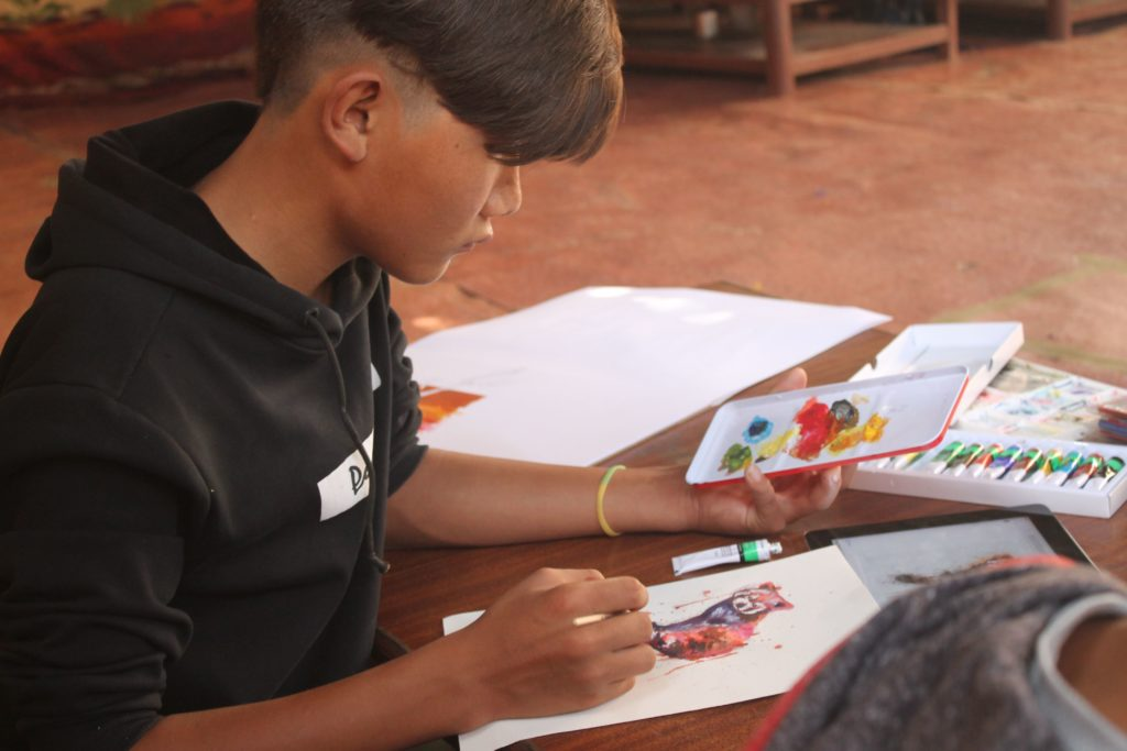 Ngawang works on some artwork.