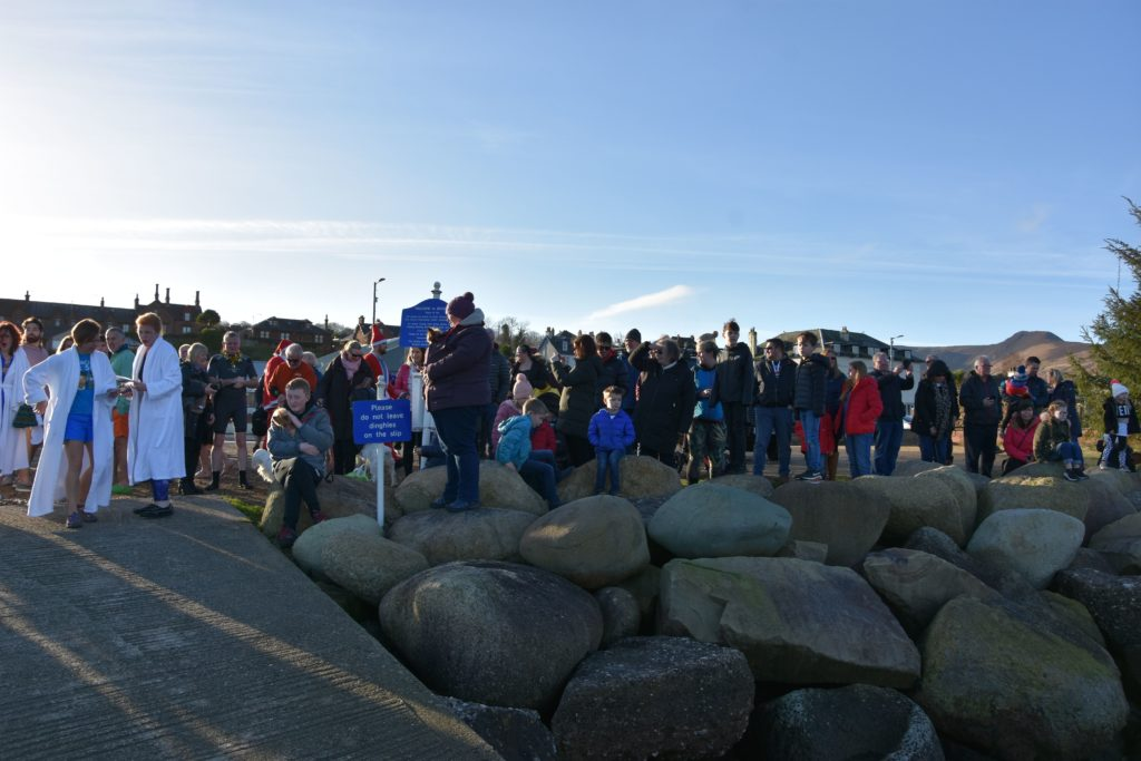 Spectators line the jetty and promenade to watch the dookers take to the water.