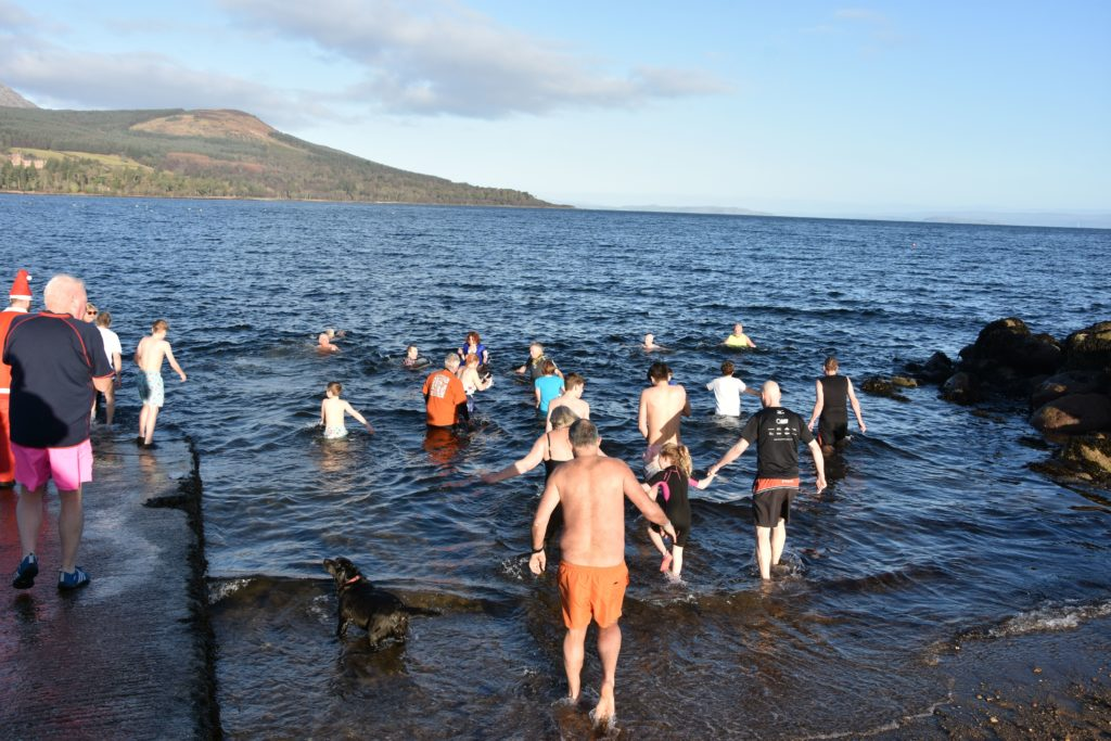 Children, dogs and dookers take to the cold waters of Brodick Bay.
