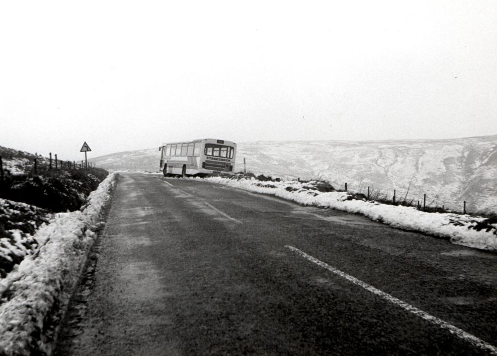 Stranded on the String Road this Stagecoach bus slid off the road and remained there all day as the rescue truck which went to its aid also struggled with the icy conditions and slid into it, causing further damage.