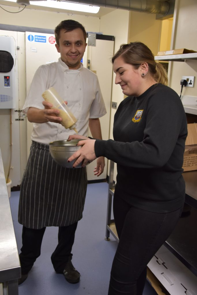 Chef James Knowles puts the finishing touches on a starter prepared by a youth club member.