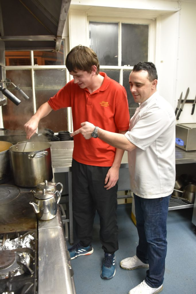 Chef Colin Miller makes sure that the gravy is made to the right consistency.
