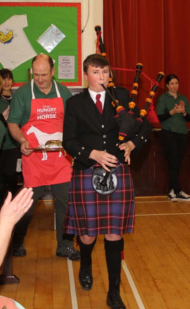 Piper Rory Currie pipes in the haggis.