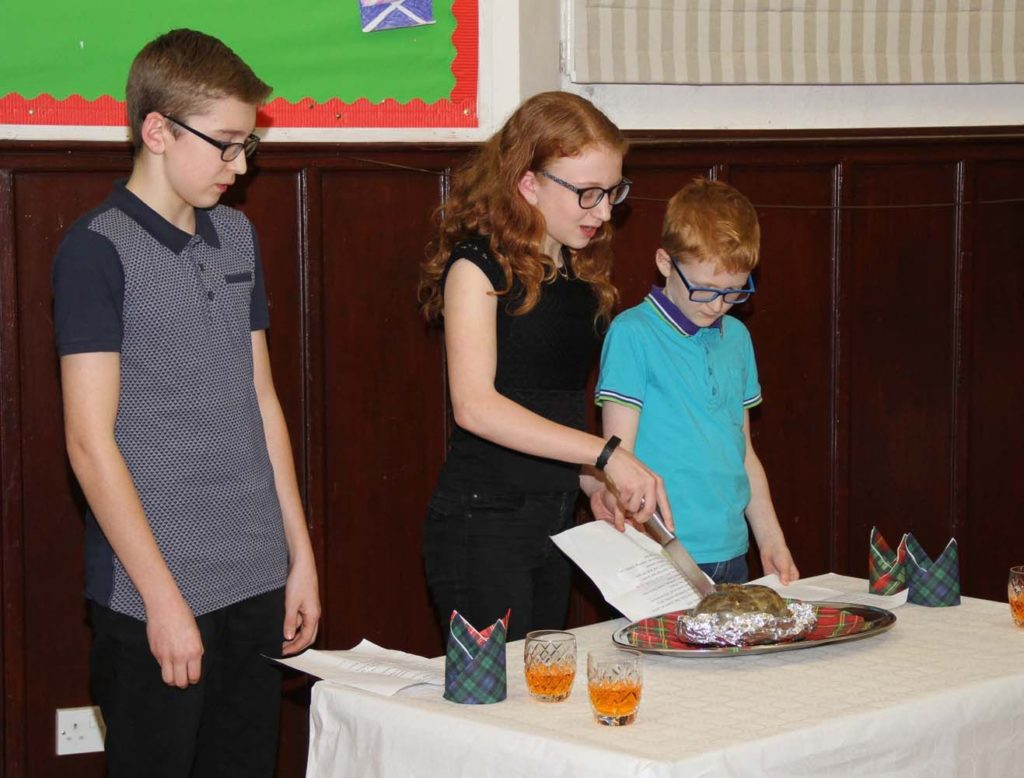 Ben, Beth and James McCarthy address the haggis.