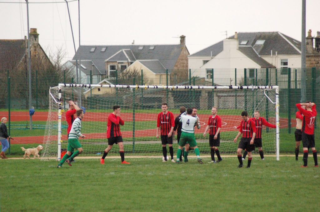 Arran players look dejected as Irvine manage to get a surprise goal past the keeper.