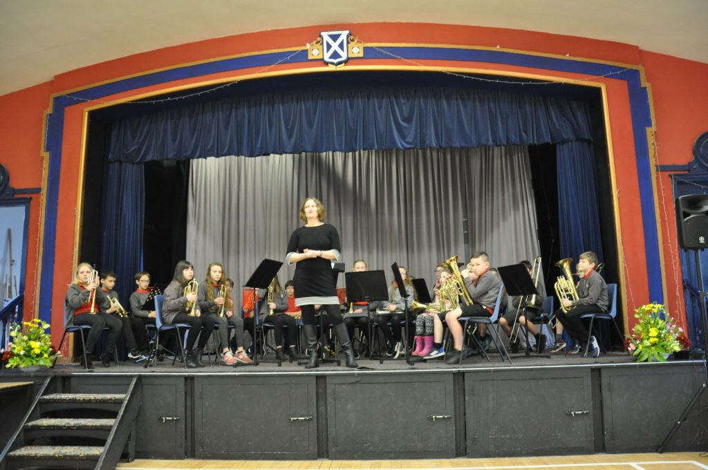 Mrs Rebecca Early introduces Lamlash Primary Brass to the stage for their performance of Morag of Dunvegan.