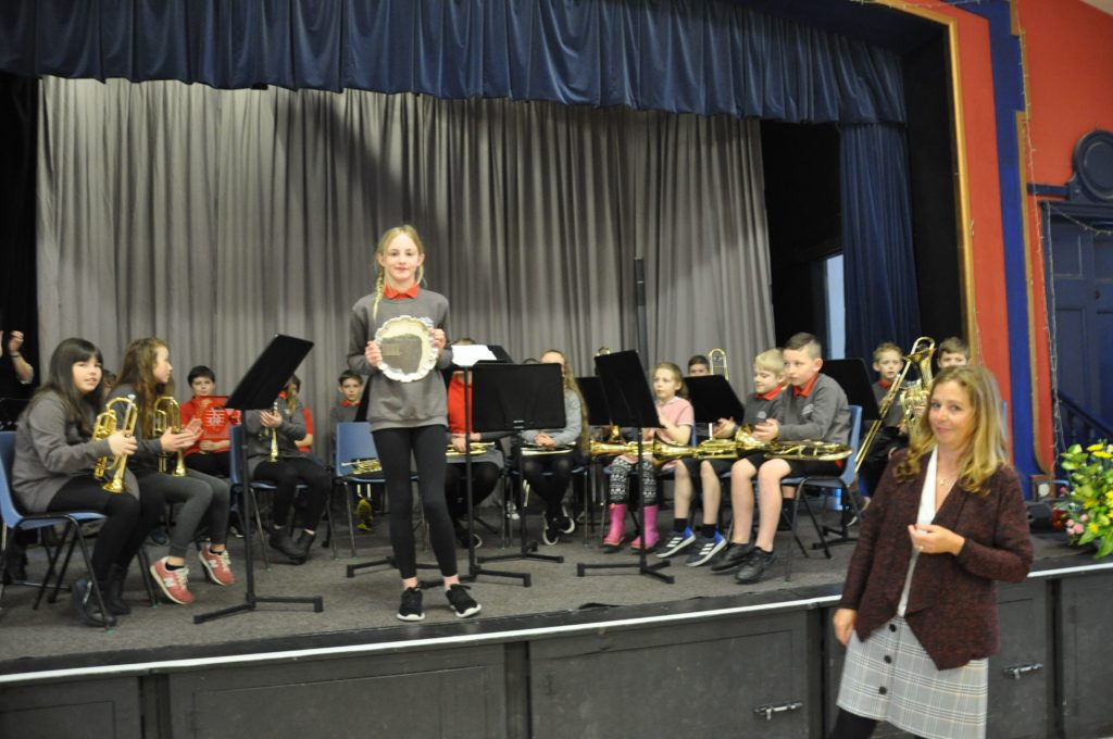 Lamlash Primary Brass receive the trophy in the primary brass section.