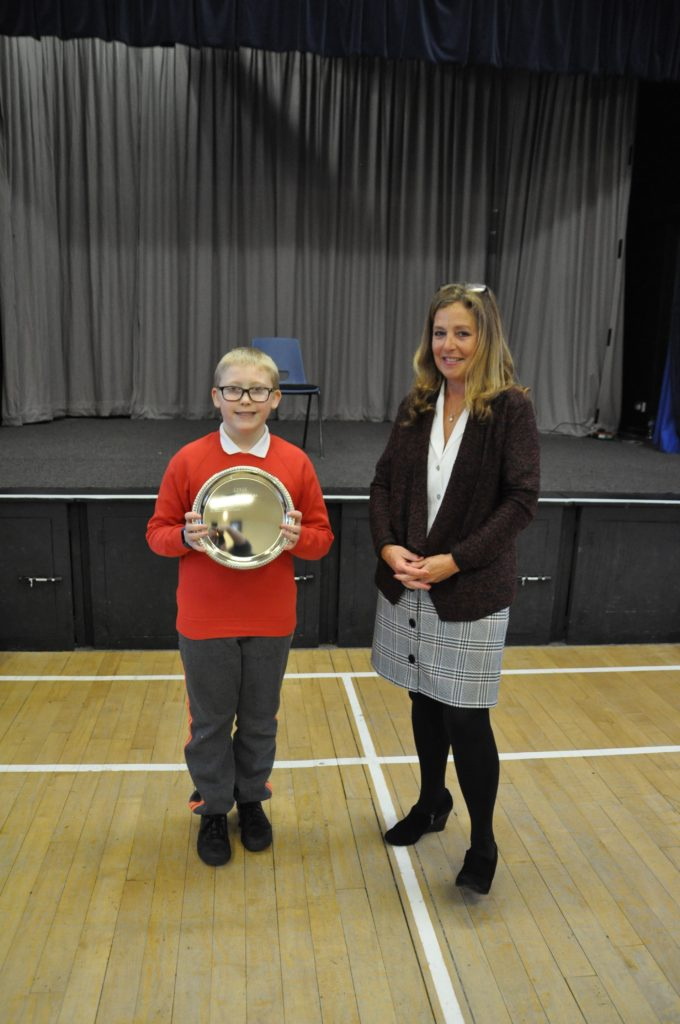 Proud winner Michael Nicholl took the salver for his performance in the woodwind category.