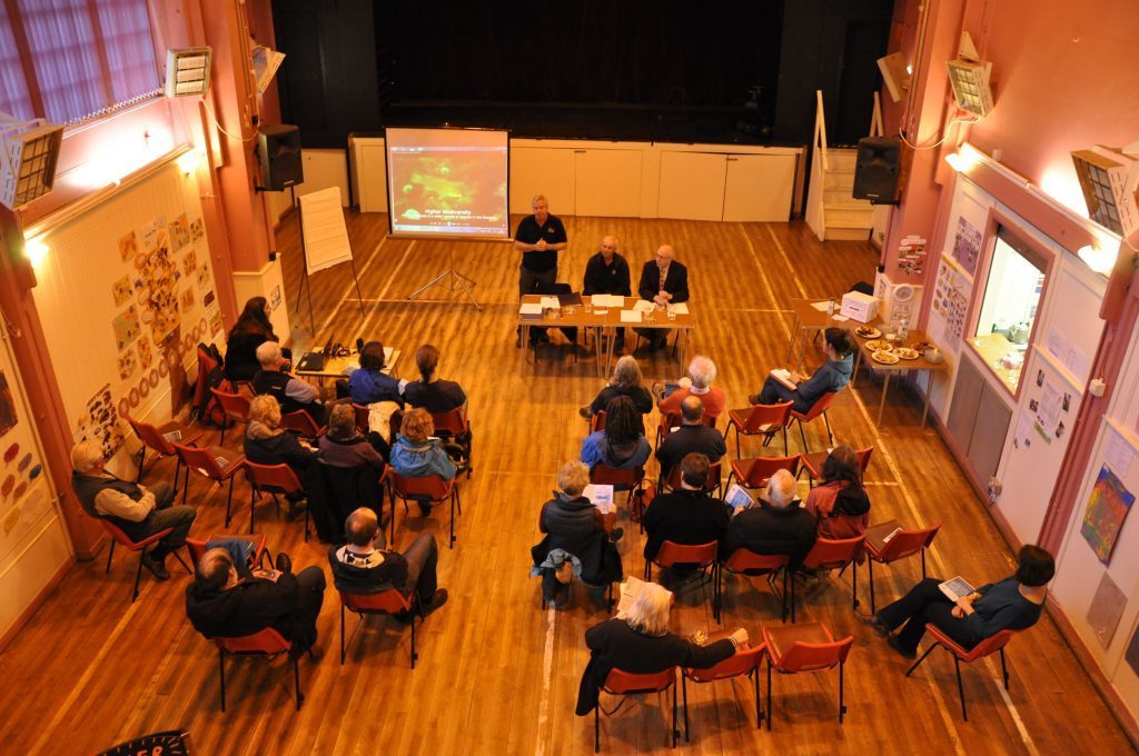 Pictured in 2017, COAST founder Howard Wood and director Paul Chandler host a public meeting to oppose a fish farm expansion proposed for Lamlash.