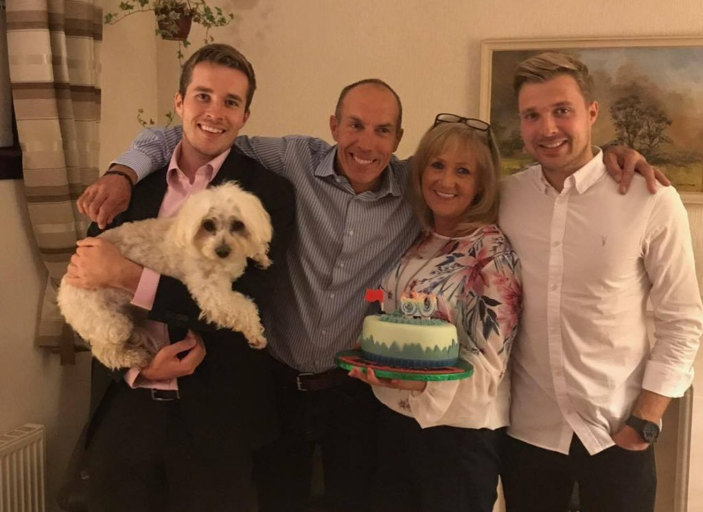 Craig Telfer with his parents and brother.