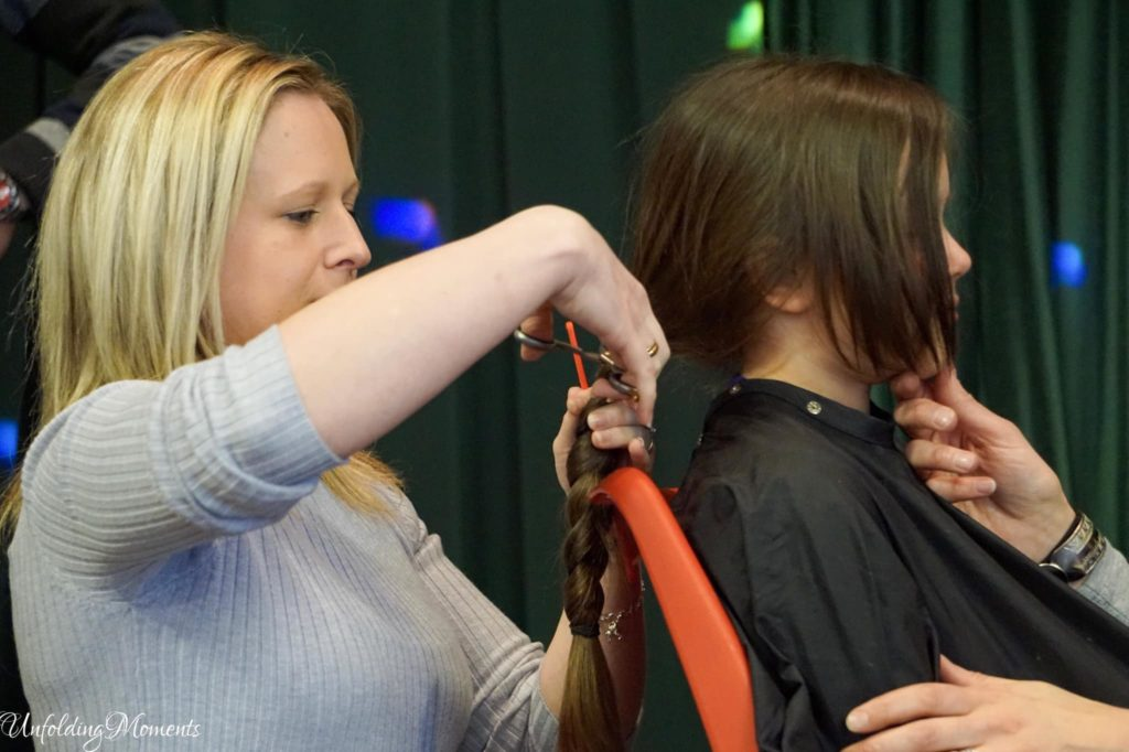 Kayla's long locks get the chop. Picture by Natalie Lambie from Unfolding Moments.