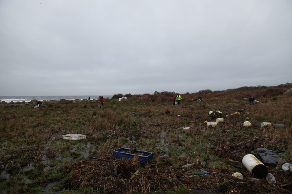 The boggy terrain is littered with flotsam and jetsam which has been carried ashore.