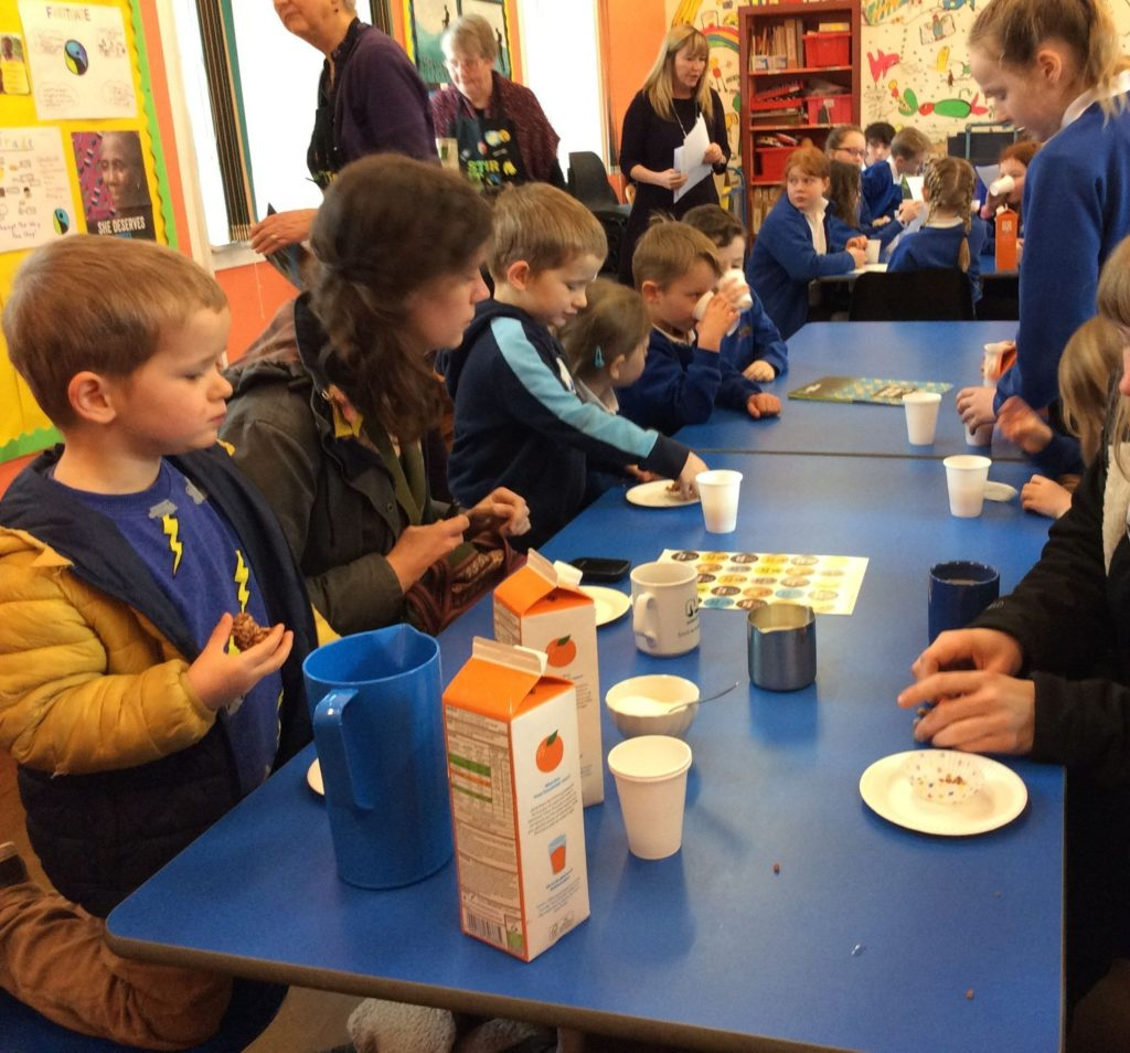 Shiskine Primary pupils tuck in to Fairtrade products during their Fairtrade coffee morning.