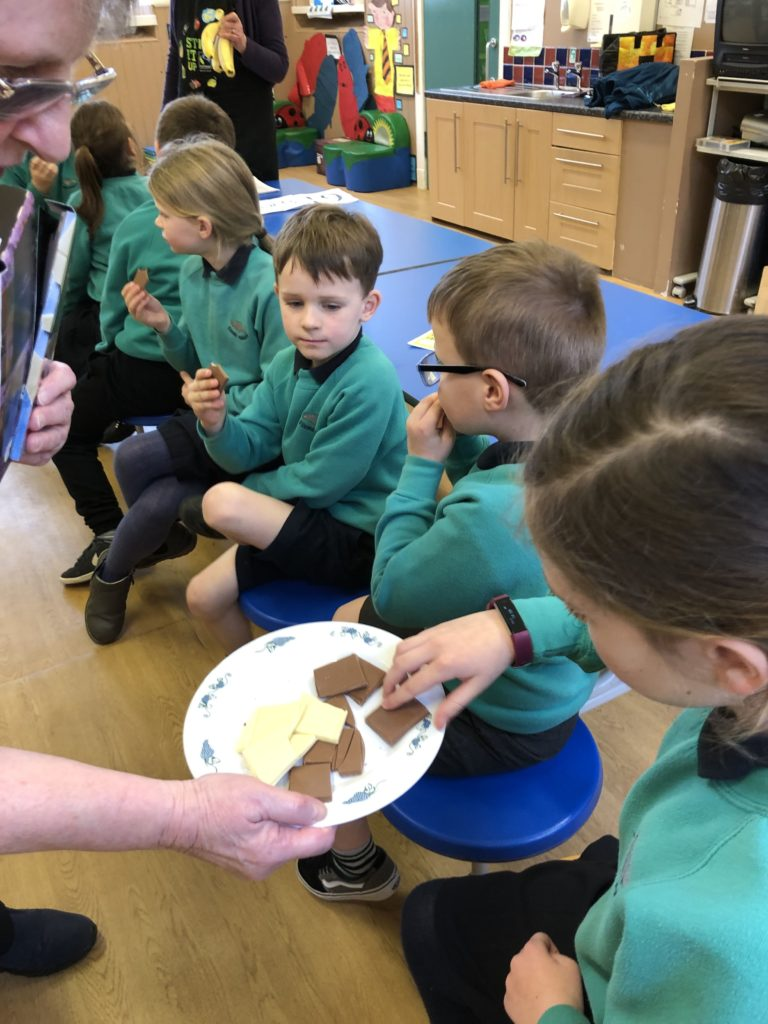 Corrie Primary pupils were more than happy to taste test Fairtrade chocolate.