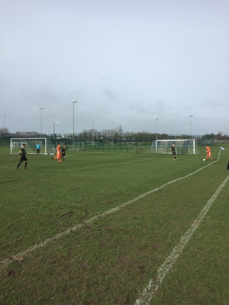 Christopher 'Babbies' MacNeil wastes no time in getting the ball back into play from the corner.