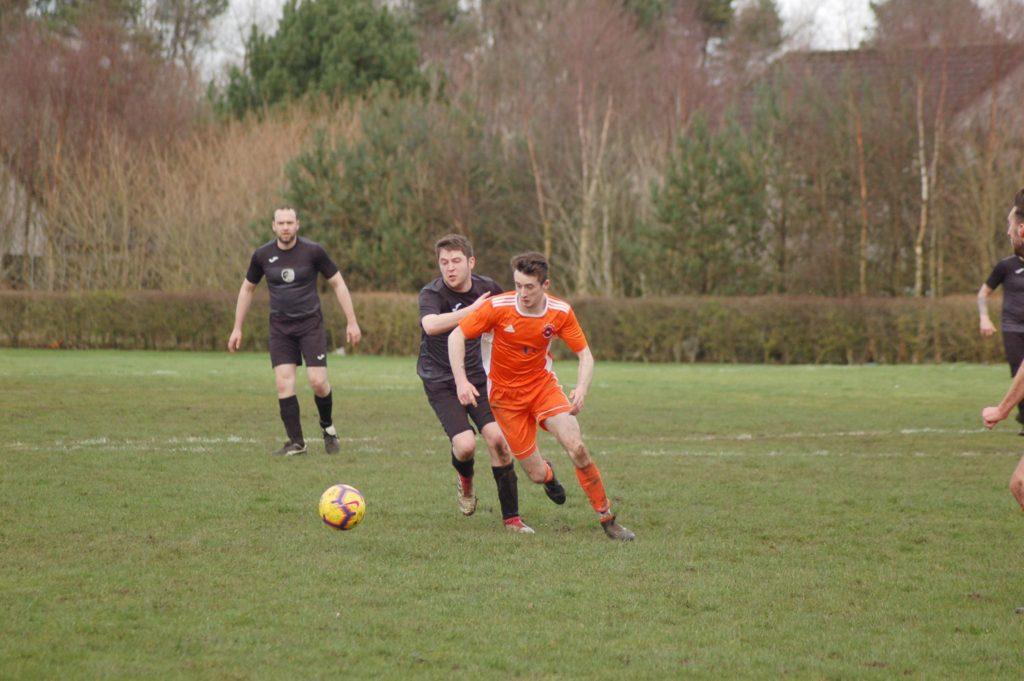 Goal scorer Johnny Sloss avoids a challenger to claim possession of the ball.