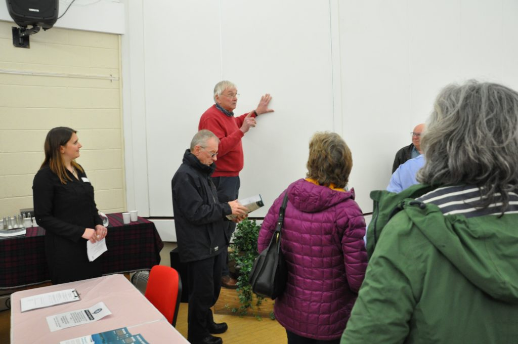 Mr Robert Cumming of the Lochranza and Catacol Community Association addresses the crowd in the village hall calling for a Q&A session.