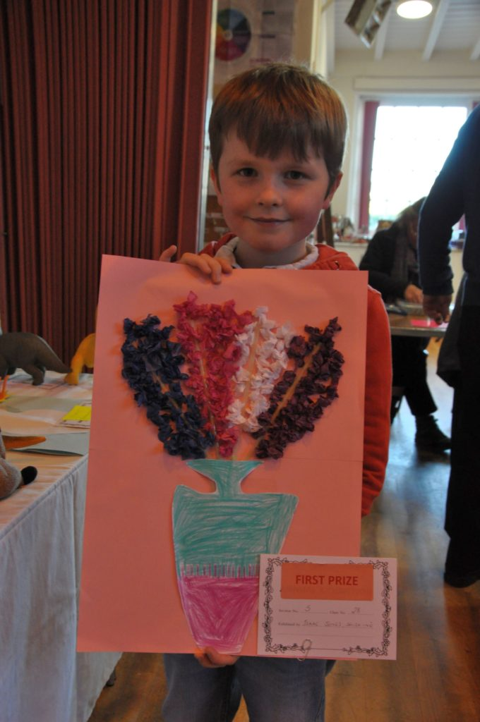Isaac Jones of Shiskine won the first prize for his creative drawing in the under eight category.