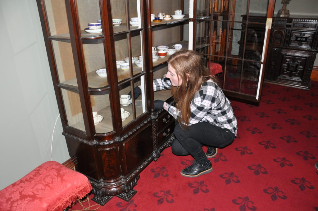 Regional curator for Ayrshire and Arran Sarah Beattie puts the finishing touches to one of the cabinets.