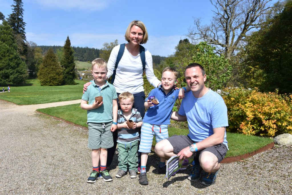 Dad Ian Blain with mum Alison are pictured with Thomas, Rory and Angus who are eating their Easter eggs.