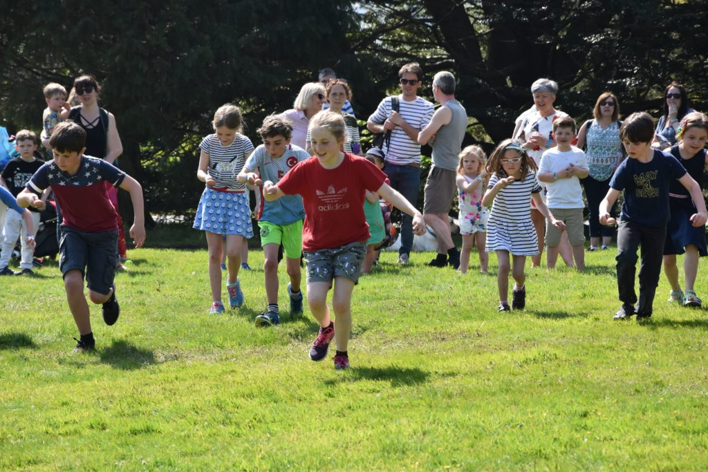 Don't drop it, children set off on the egg and spoon race.