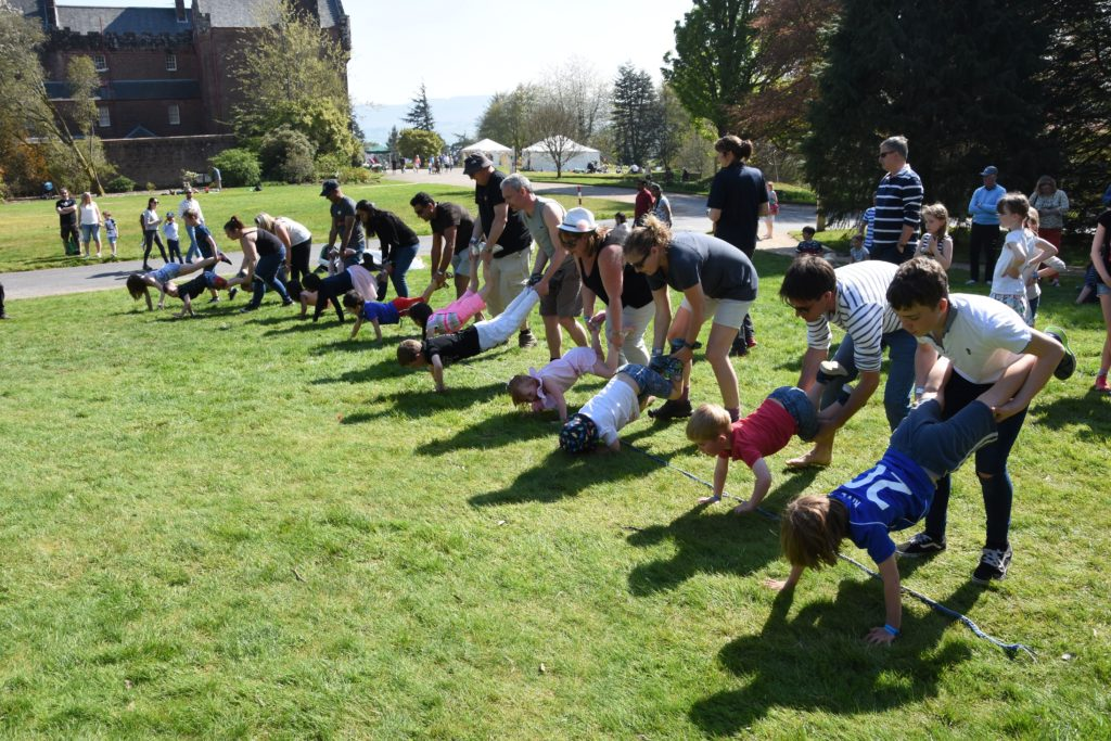Racers at the ready in the wheelbarrow race.