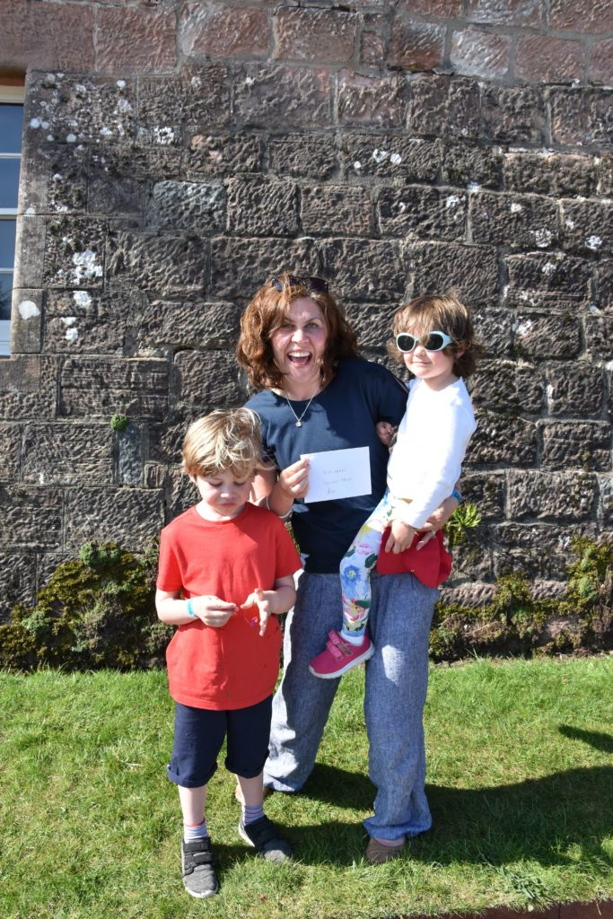 Mum Caroline McArdle and Bonnie are delighted to win second place in the duck derby while son Mac seems less impressed.
