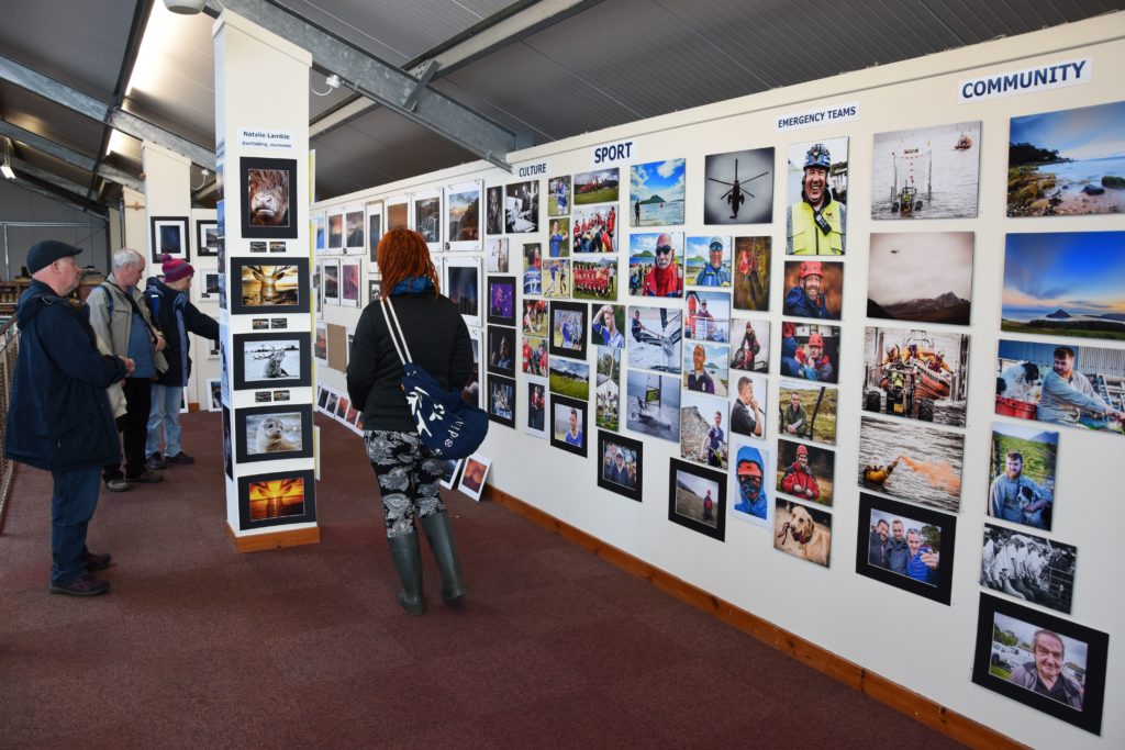 Visitors spend some time browsing the #9YearsOnArran exhibition.