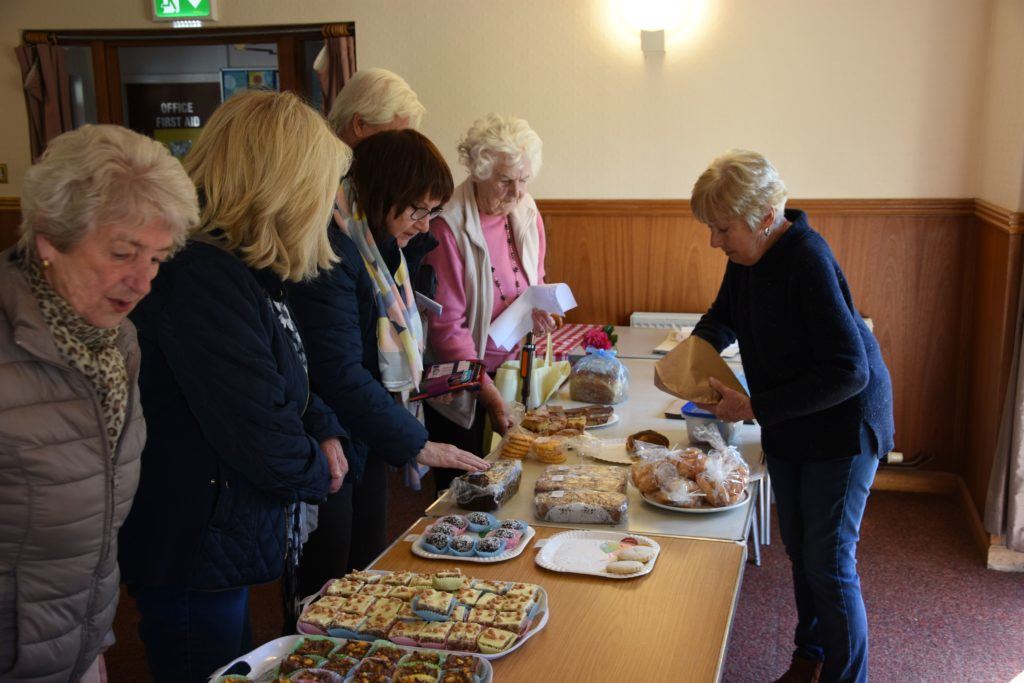 Volunteer Elsbeth Lang did a roaring trade at the home baking stall.