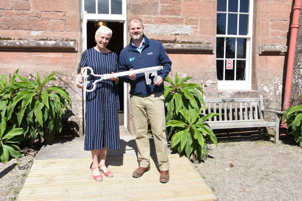 They key to the castle, Sheila Gilmore and Jared Bowers officially open the castle.