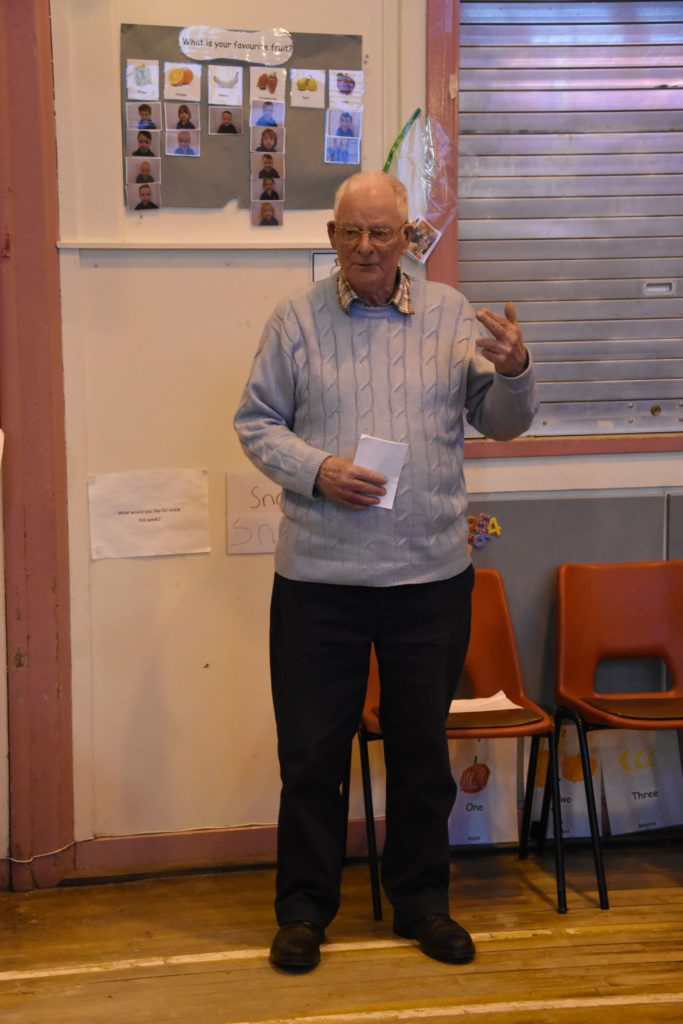 Chairman of the Community Hall Association, John Sillars addresses the attendants to share his views on the subject.