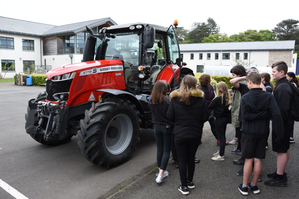 Pupils are allowed to climb into the Massey Ferguson tractor to see what it would be like to operate the machine.