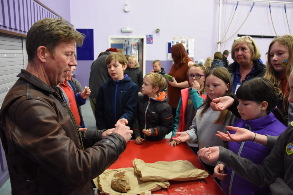 George Grassie of Blackwater Bakehouse gives each pupil a taste of the bread that is produced in his bakery at Blackwaterfoot.