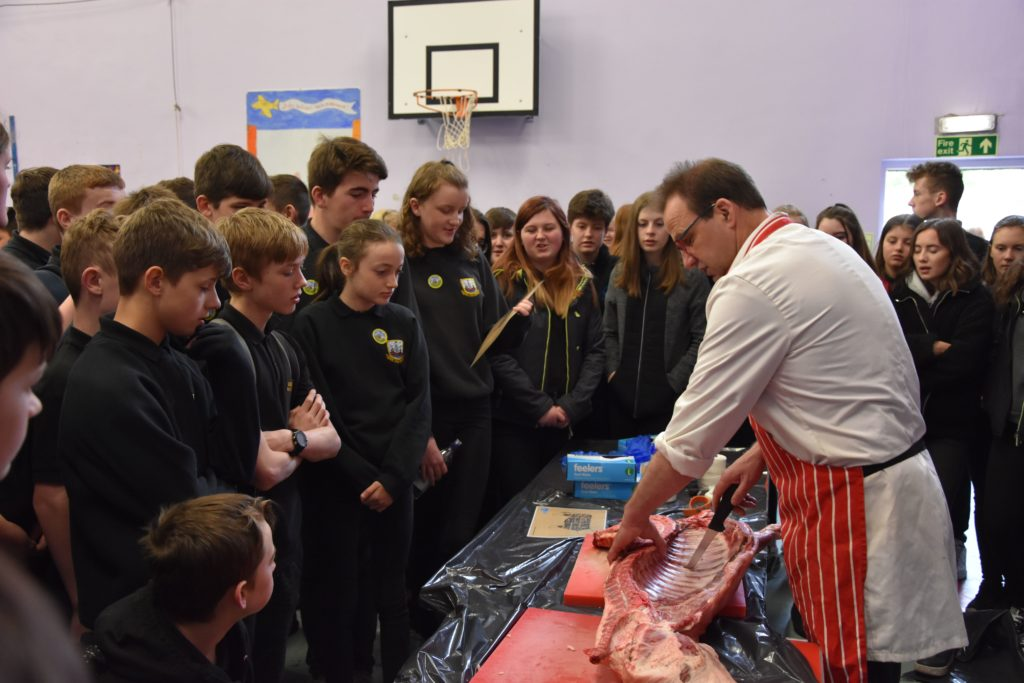 Butcher David McKinnon shows the pupils the various cuts of meat and explains the butchering process.
