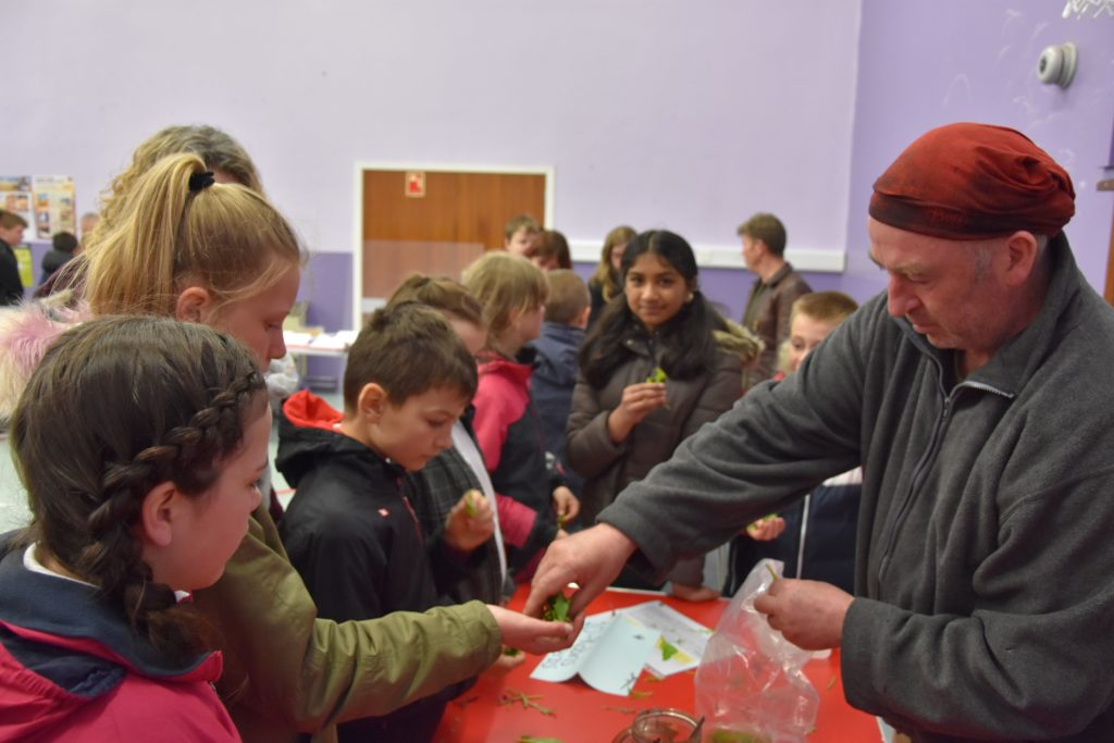 Robin Gray asks pupils to identify the taste of the various herbs he has given them to sample.