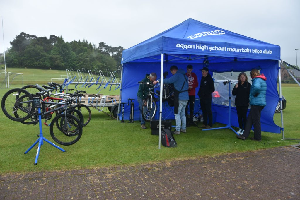 Arran High School Mountain Bike Club members undertake free bicycle MOTs.