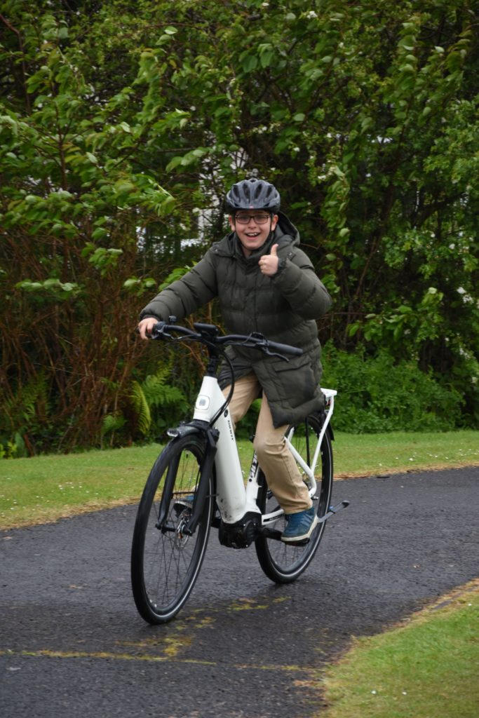 It's so easy! An eBike gets the thumbs up from a young tester.