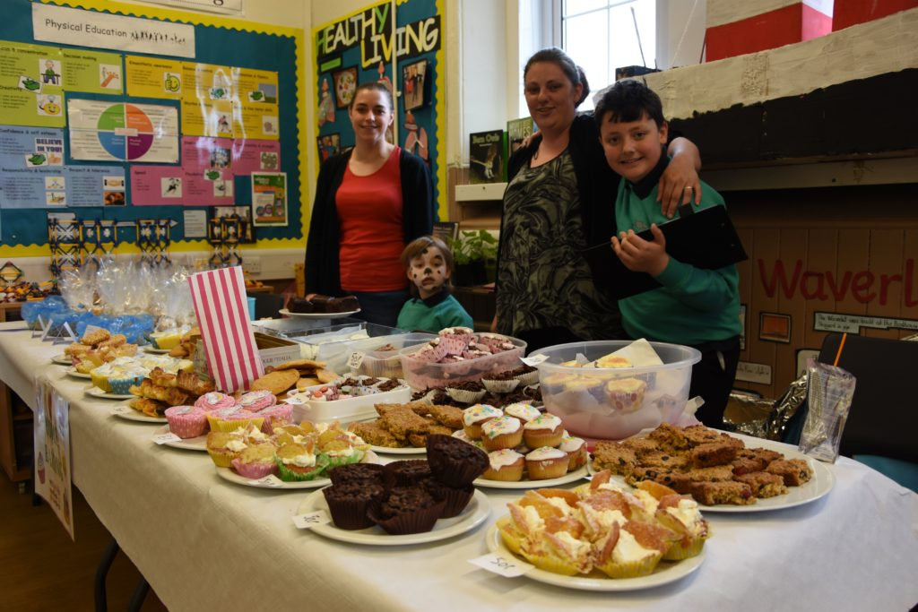 Too many options to choose just one, parents and children sell tempting treats at the home baking stall.