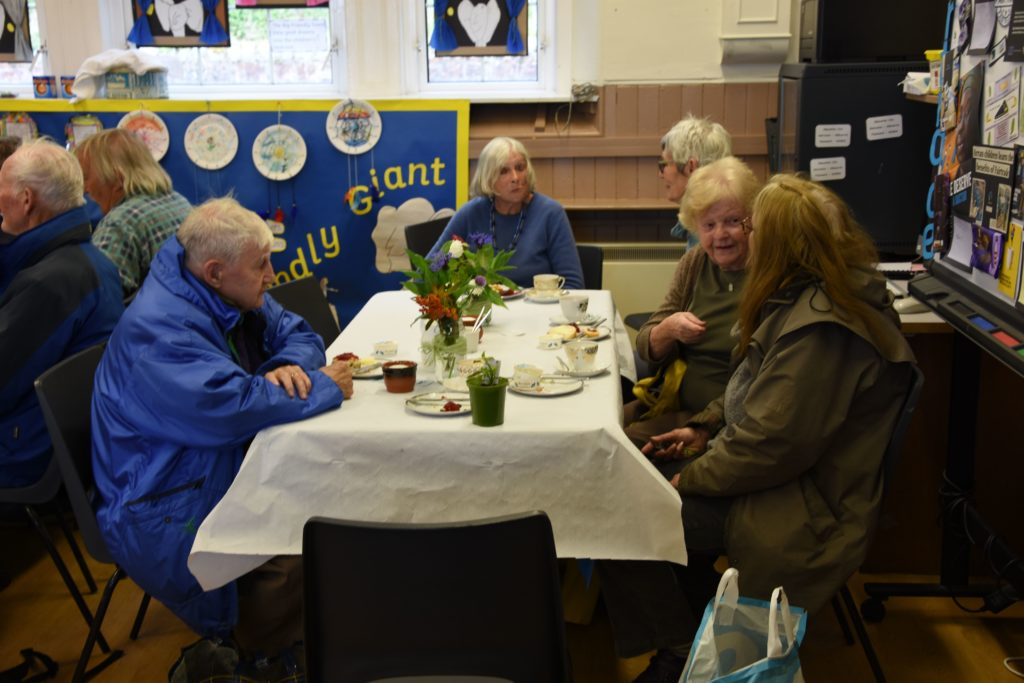 Visitors enjoy refreshments and home baking at the seating area.