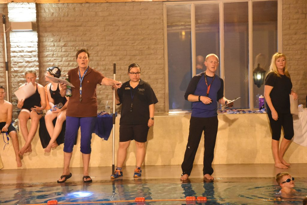 Sally Hunter and Barry Smith ensure that the relay swimmers are in position.
