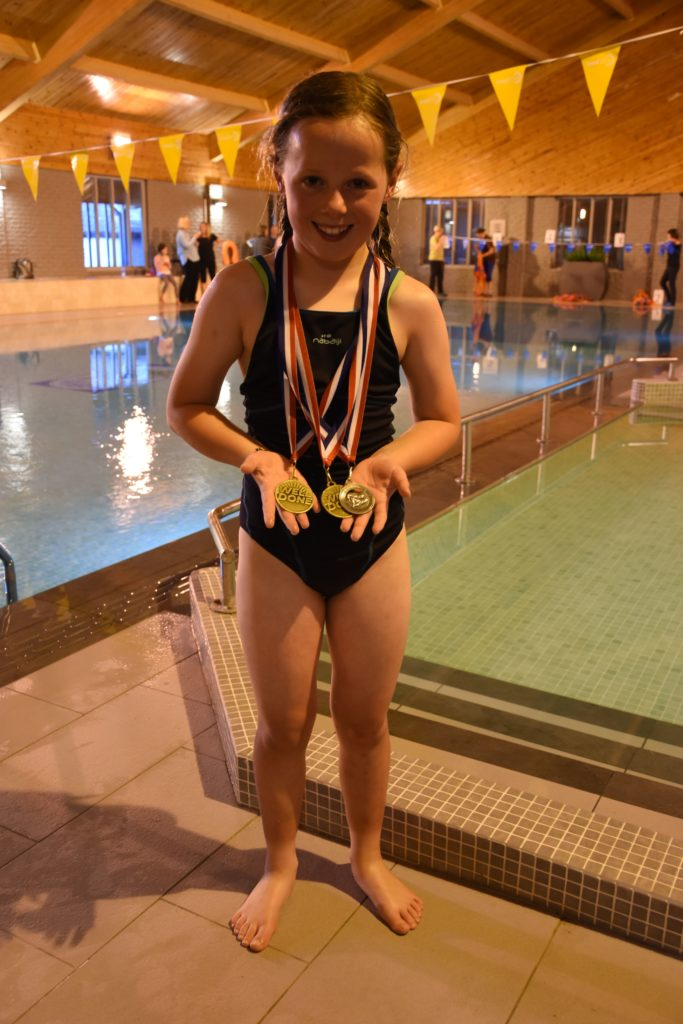 Accomplished swimmer Kitty Townsend shows off her medal haul.