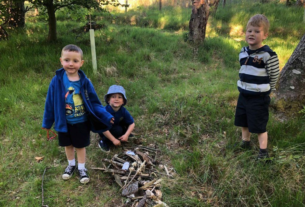 A group of youngsters get to work building their fairy house. Photo: Arran Ranger Service.
