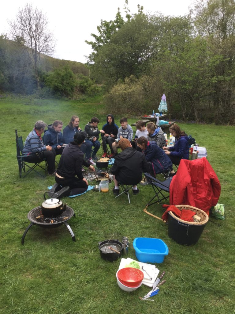 Pupils sample the fruits of their labour at the outdoor cooking day.
