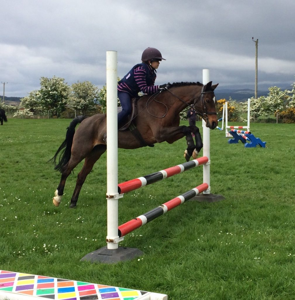 Rosie McNamara and Kizzy fly round the jumping.