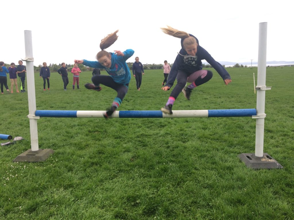 Niamh Gosman and Harriet Lucas fly over the traditional unmounted 'chase me charlie'.