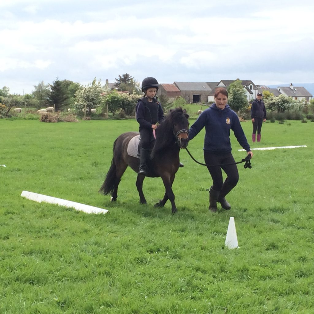 Sophie Smythe and Cocoa perform their dressage test.