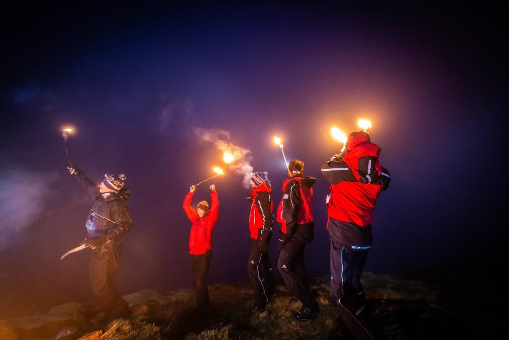 Can you see us ? Participants wave their torches in the direction of Ben Lomond.