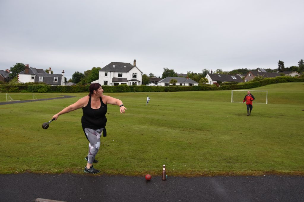 In full swing, Yvonne launches the hammer across the field.