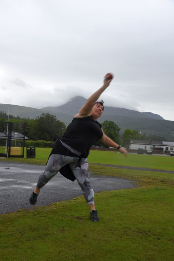 Yvonne practises shot put with a weight far exceeding the standard weight for women's competition.