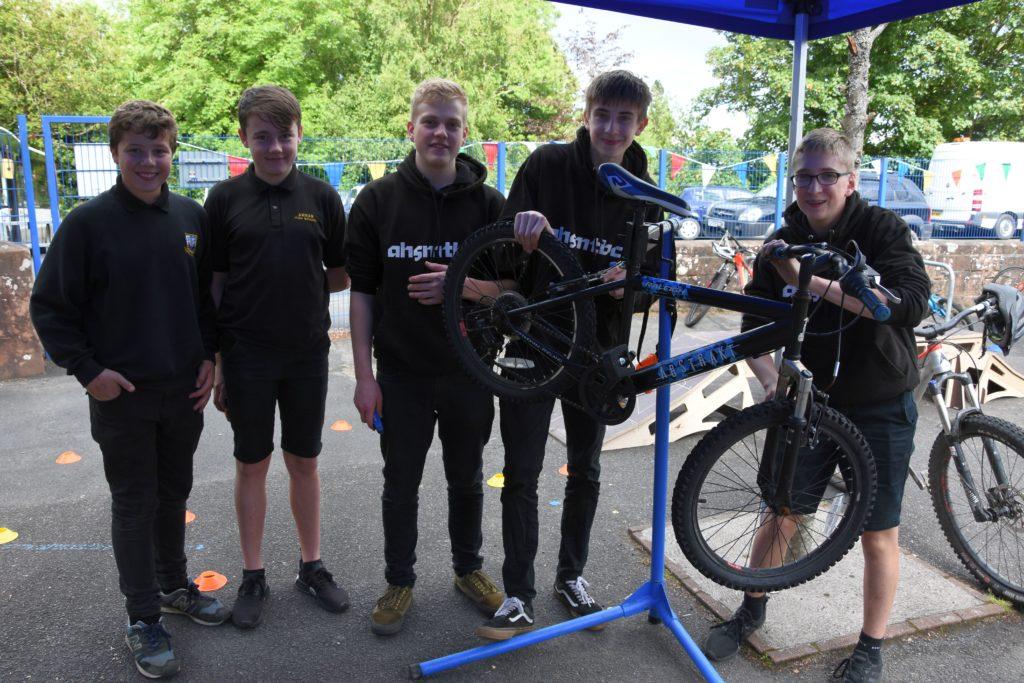 At your service, Arran High School Mountain Bike Club members undertake free repairs on bicycles.